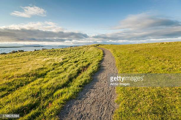 Path on grassy hill on small Island