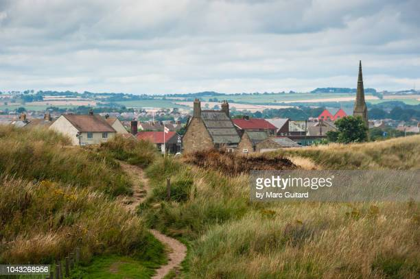path through the dunes towards amble, northumberland coast path, northumberland, england - northumberland stock pictures, royalty-free photos & images