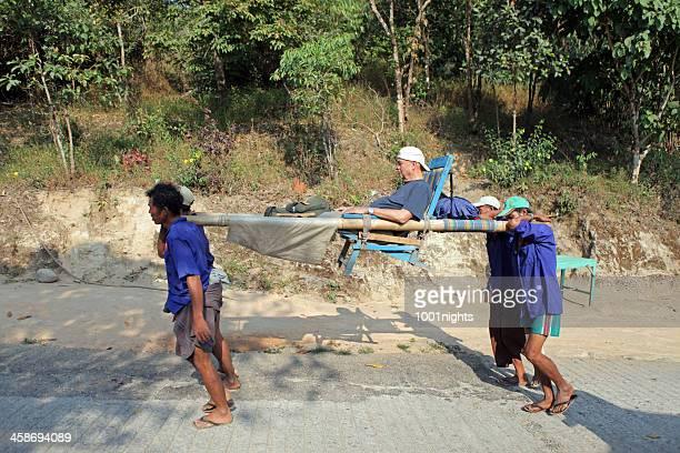 path to kyaiktiyo pagoda, myanmar - sedan chair stock photos and pictures
