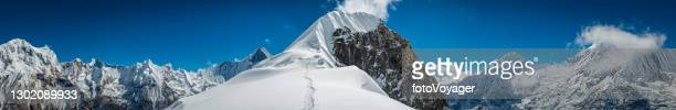 path to summit of highest mountain snowy peak panorama himalayas nepal - annapurna south stock pictures, royalty-free photos & images