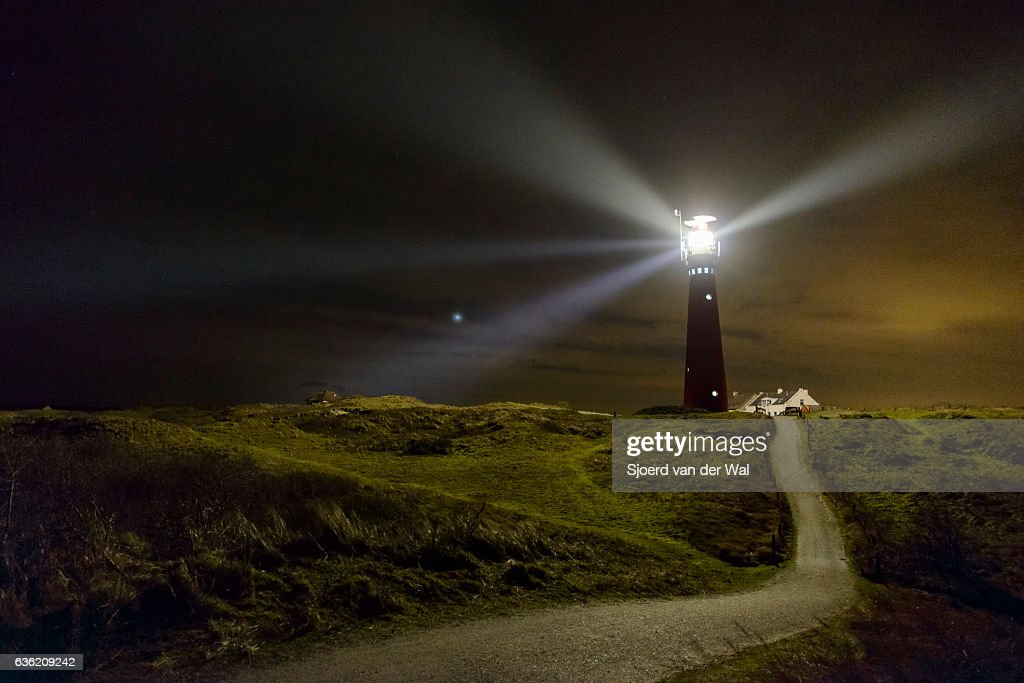 Path to the lighthouse in the dunes at night : Stock Photo