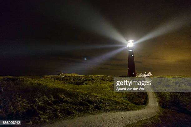 Path to the lighthouse in the dunes at night