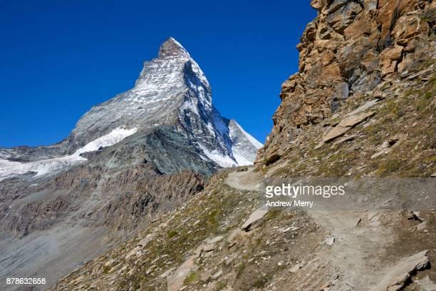 Path, track or trail to the Matterhorn with rock strata, via Hörnli Hut (Hörnlihütte), base camp Matterhorn, a popular route for the ascent of the Matterhorn.