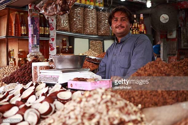 pathan dry fruit vendor in empress market, karachi pakistan - sind stock photos and pictures