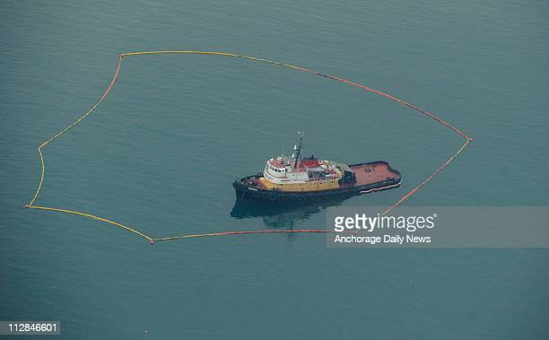 Pathfinder, a 136-foot tug, is surrounded by a spill containment boom on Thursday, December 24, 2009. The tug grounded on Bligh Reef on Wednesday...