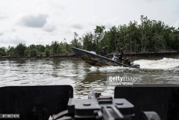 NNS Pathfinder of the Nigerian Navy forces patrol in the creeks to look for illegal oil refineries on April 19 2017 in the Niger Delta region near...