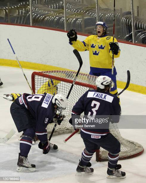 Pathrik Vesterholm of Team Sweden celebrates a goal at 11:01 of the first period by teammate Joakim Nordström against Team USA at the Lake Placid...
