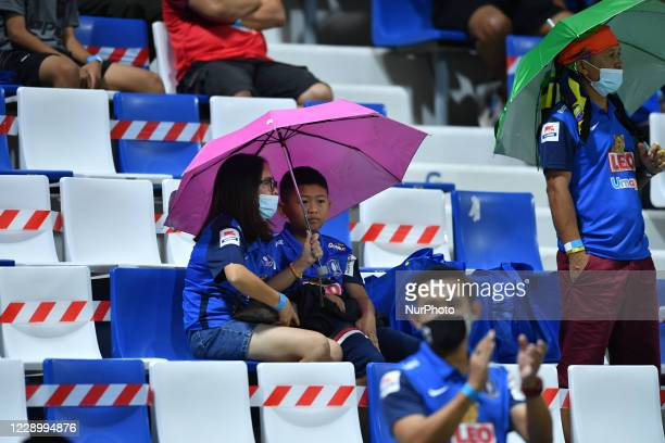 Pathum fans in the rain during a Toyota Thai League 2020 match between BG Pathum United against Buriram United at Leo stadium on October 10, 2020 in...