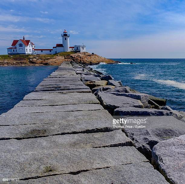 pathway leading to lighthouse against the sky - lowell massachusetts stock pictures, royalty-free photos & images