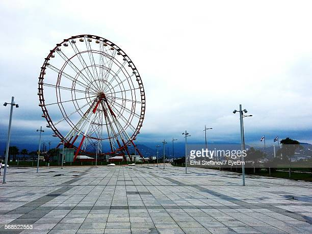 Pathway Leading Towards Ferris Wheel Against Clear Sky