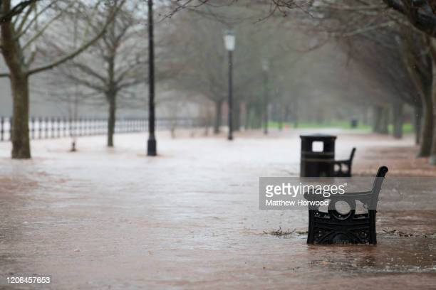 A pathway submerged in water as the River Usk breaches its banks on February 15 2020 in Brecon United Kingdom The Met Office have issued an amber...