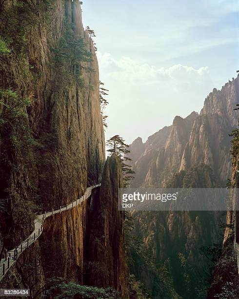 pathway winding through chinese mountian landscape - anhui province stock pictures, royalty-free photos & images