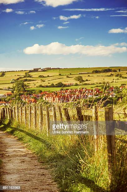 Pathway, wooden fence, in rural setting