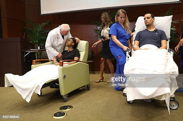 Patience Carter and Angel Santiago prepare to leave after speaking to the media from the Florida Hospital about being shot in the Pulse gay nightclub...