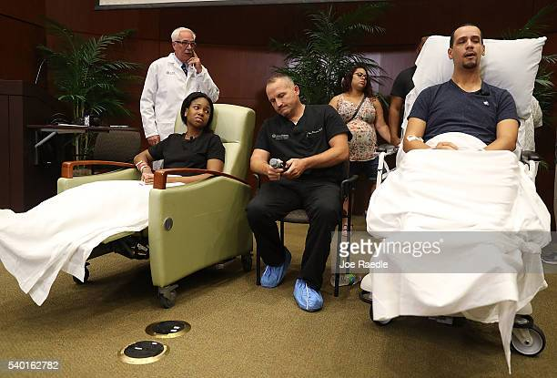 Patience Carter and Angel Santiago sit with their surgeon Dr Brian Vickaryous as they speak to the media from the Florida Hospital about being shot...