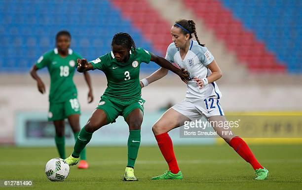 AZ ZARQA' JORDAN OCTOBER 04 Patience Dike of Nigeria challenges Anna Patten of England during the FIFA U17 Women's World Cup Jordan Group C match...