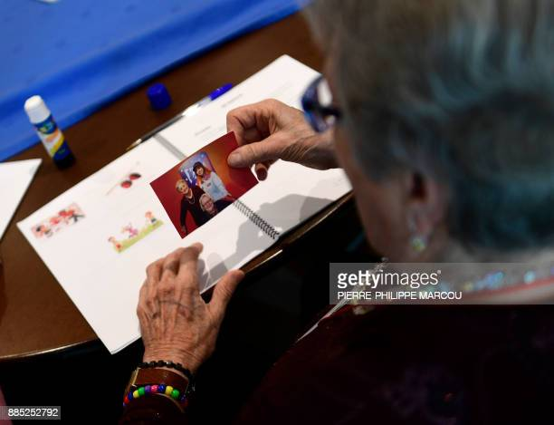 A patient affected by Alzheimer's disease attends a special therapeutic session in Madrid on November 28 2017 Eight senior citizens huddled around a...