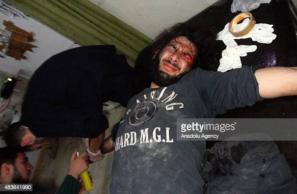 A patient affected by the chlorine gas attack receives treatment at a hospital in the Arbin town of Damascus Syria on August 11 2015 Assad regime...