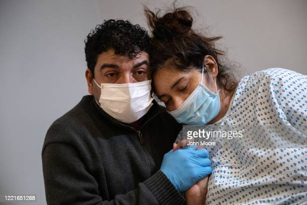 COVID19 patient and Guatemalan asylum seeker Zully is comforted by her husband Marvin also Covidpositive after she arrived home by ambulance from...