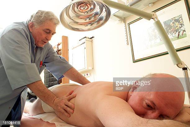 Patient And Health Professional Relaxing Massage Of The Spine On Patient Who Underwent Suregry For Herniated Disc Laminectomy Laminectomy Is The...
