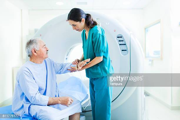 patient and nurse in cat scan in a hospital. - oncology stock photos and pictures