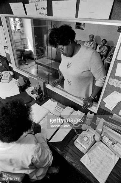 Patient approaches the counter, at an inner city medical clinic serving poor patients in Roxbury, Boston, Massachusetts, 1978.