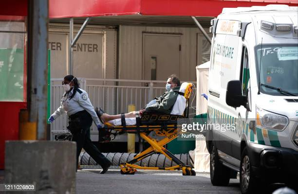A patient arrives to Elmhurst Hospital Trauma center Elmhurst Hospital Trauma Center In Queens Borough of New York City Continues Receiving Covid19...