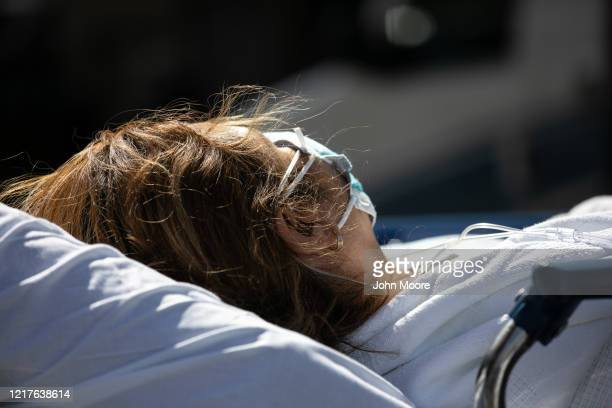 Patient arrives to the Montefiore Medical Center Moses Campus on April 07, 2020 in the Bronx borough of New York City. Coronavirus patients were...