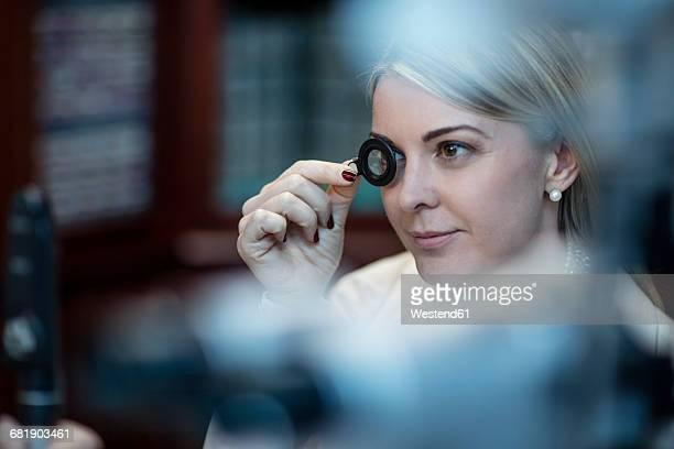 patient at optometrist trying different lenses - lens optical instrument stock pictures, royalty-free photos & images