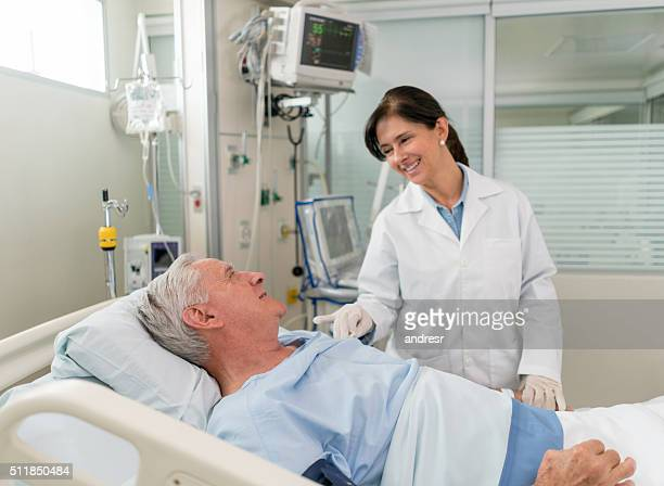 Patient at the ICU talking to the doctor