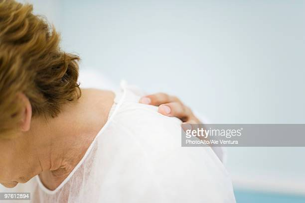 patient being consoled by doctor, head down, cropped - hand on shoulder stock pictures, royalty-free photos & images