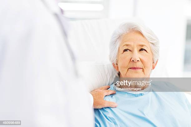 Patient Being Consoled By Doctor In Hospital Ward