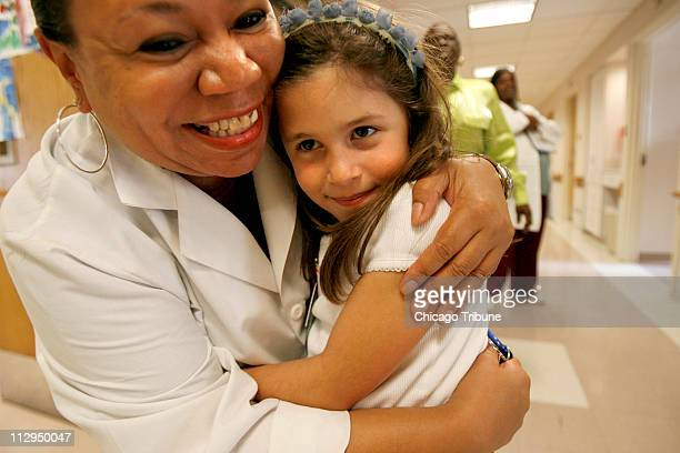 Patient Care Technician Karen Breedlove hugs Lilly Jaffe who was diagnosed with insulindependent diabetes when she was only a month old during...
