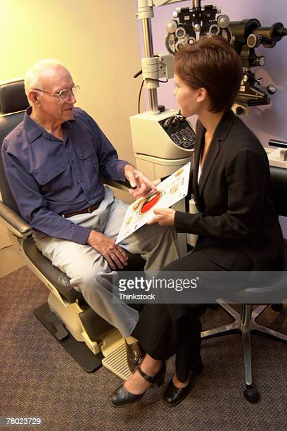 Patient consulting with optometrist
