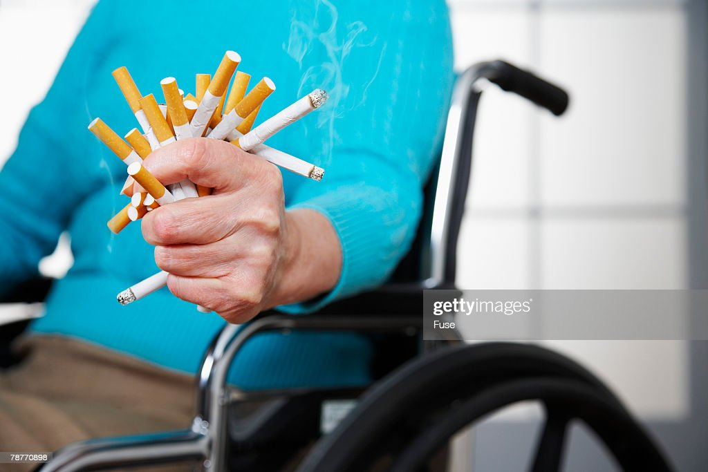 Patient Crushing Cigarettes : Stock Photo