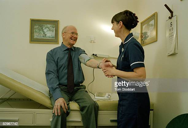 Patient David Cummings is examined by nurse Lindsey Myatt at the Hermitage surgery in Swindon Mr Cummings is extremely happy with the service he...
