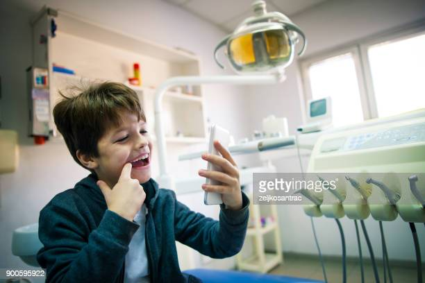 Patient doing photo selfie in dental office