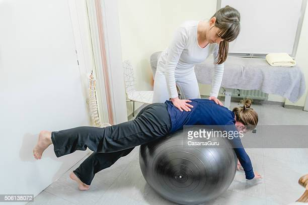 Patient Doing Pilates with Physical Therapists, Rehabilitation After Back Problem