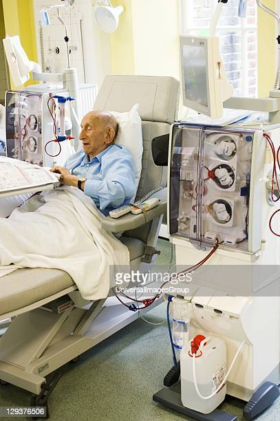 Patient during dialysis Kidney patient on his regular visit to the renal dialysis ward of a London hospital where he is connected to a hemodialysis...