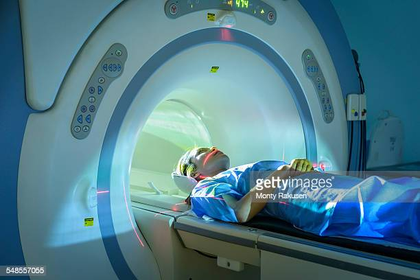 Patient entering Magnetic Resonance Imaging (MRI) scanner