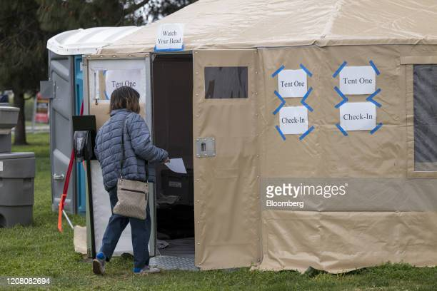 A patient enters a tent at a free Covid19 testing site in Hayward California US on Monday March 23 2020 Governor Newsom on March 19 ordered that all...