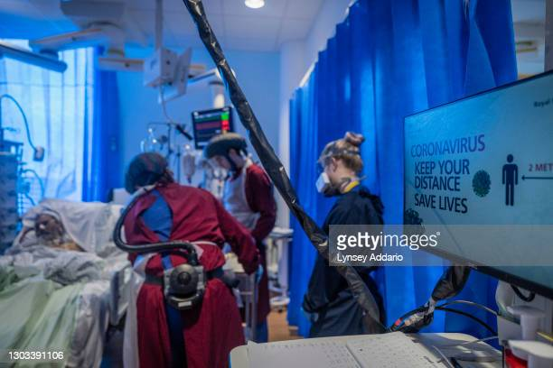 Patient, Foysal Ahmad 51, is check by medical staff before his physical therapy in Critical Care at Royal Papworth Hospital on June 15, 2020 in...