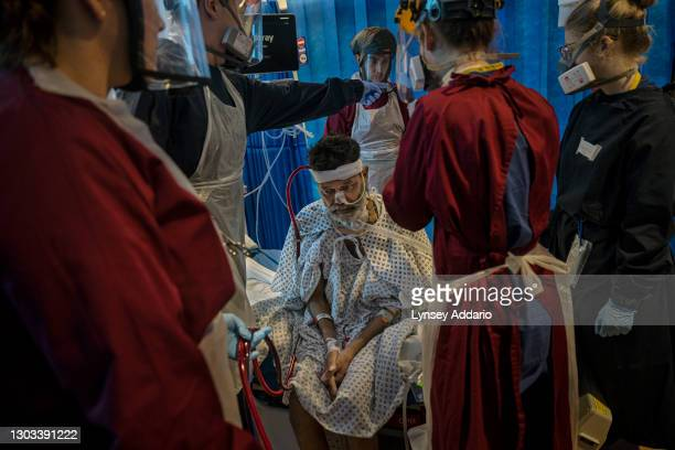 Patient, Foysal Ahmad rests before attempting to walk with the help of medical staff and physiotherapists at Royal Papworth Hospital on June 15, 2020...