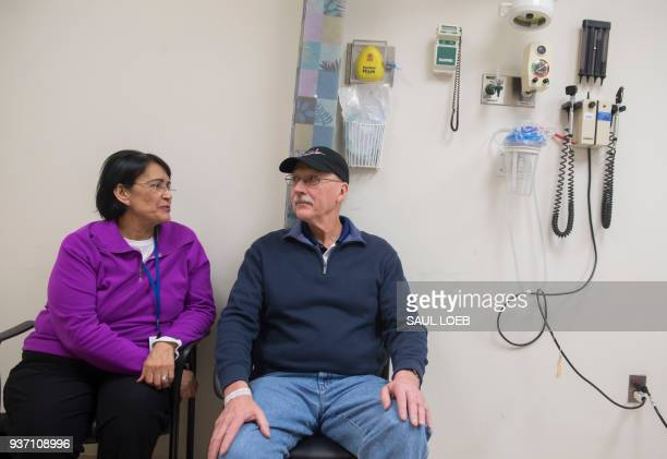 Patient Fred Janick a survivor of metastatic cancer and his wife Carol wait to speak with Dr Christian Hinrichs an investigator at the National...