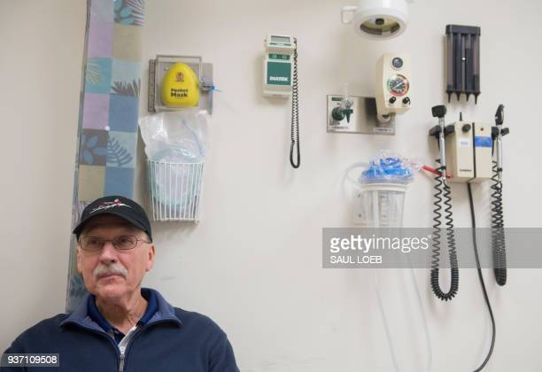 Patient Fred Janick a survivor of metastatic cancer waits to speak with Dr Christian Hinrichs an investigator at the National Cancer Institute in...