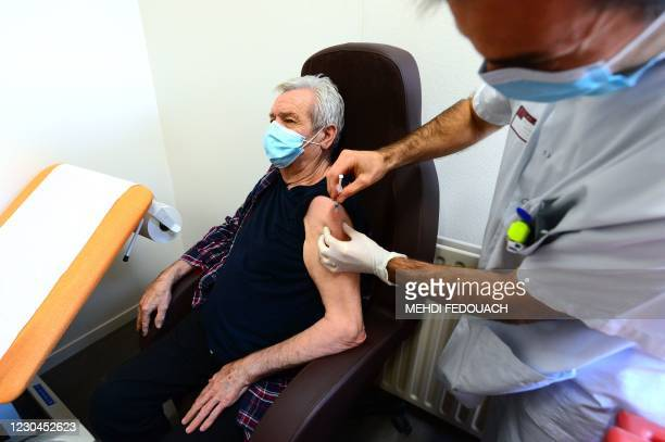 Patient gets vaccinated with the Pfizer-BioNTech Covid-19 vaccine at an EHPAD , in Lormont, on January 6, 2021.