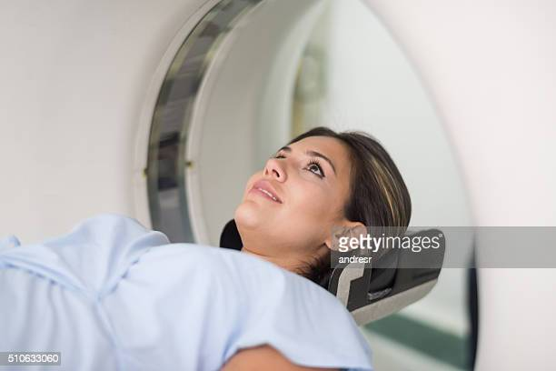 patient getting a cat scan at the hospital - cat scan machine stock pictures, royalty-free photos & images