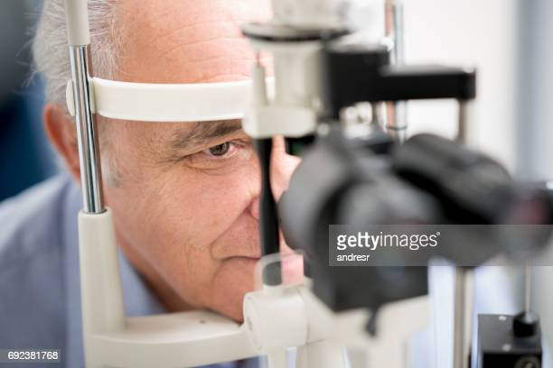 Patient getting an eye exam at the optician