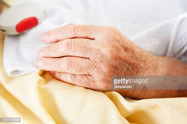 patient hand in hospital emergency call
