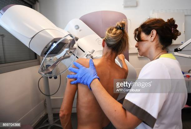 A patient has a mammogram on October 9 2017 at the PaoliCalmette institute a fight against cancer regional centre / AFP PHOTO / ANNECHRISTINE...